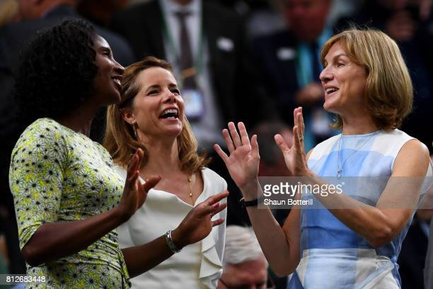 Denise Lewis, Darcey Bussell and Fiona Bruce talk in the centre court royal box on day eight of the Wimbledon Lawn Tennis Championships at the All...