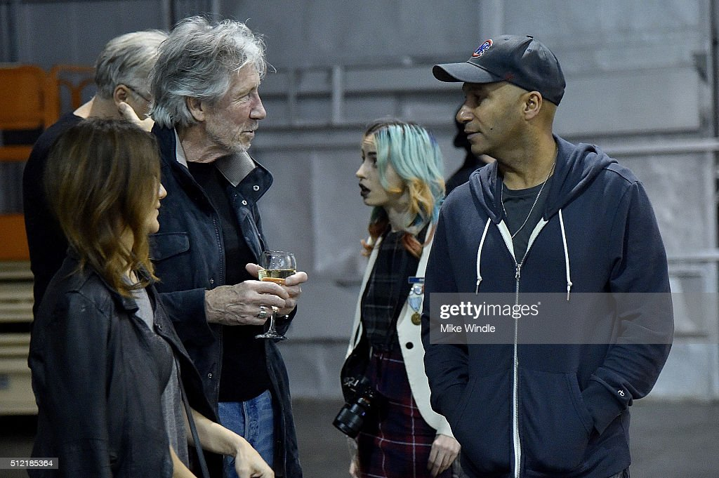 Denise Luiso, Roger Waters and Tom Morello attend in celebration of the release of the Limited Edition box set of the film 'Roger Waters The Wall', Roger Waters hosts Los Angeles Event for Brazilian artists Osgemeos' interpretation of 'The Wall' on February 24, 2016 in Los Angeles, California.