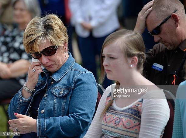 Denise Morris wipes away tears during the Colorado Department of Transportation Remembrance Day at CDOT headquarters April 14 2016 Her granddaughter...