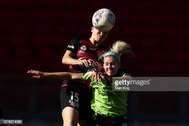 Denise O'Sullivan of Canberra United competes for the ball against Talitha Kramer of the Wanderers during the round six W-League match between the...