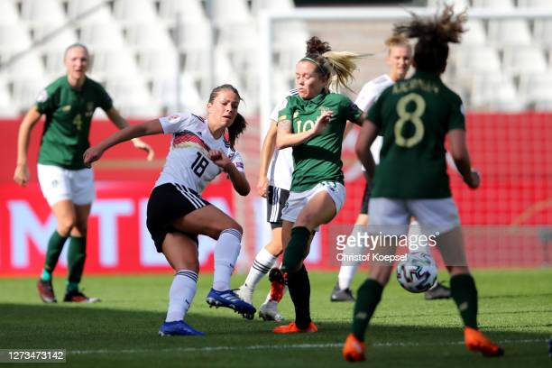 Denise O'Sullivan of Ireland challenges Melanie Leupolz of Germany during the UEFA Women's EURO 2022 Qualifier match between Germany and Ireland at...