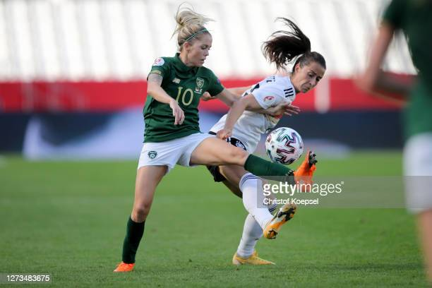 Denise O'Sullivan of Ireland challenges Sara Daebritz of Germany during the UEFA Women's EURO 2022 Qualifier match between Germany and Ireland at...