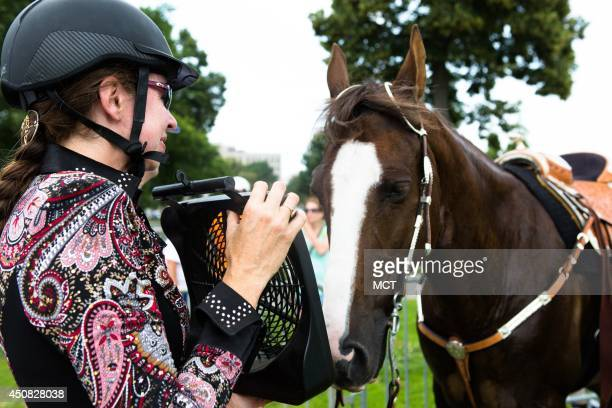 Denise Parsons from Boyds Md uses a fan to cool off her horse Benny during a rally on Capitol Hill in Washington Wednesday June 18 to help support...