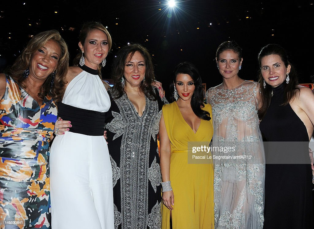 Denise Rich (L), Kim Kardashian (3rd from R), Heidi Klum (2nd from R) attends the 2012 amfAR's Cinema Against AIDS during the 65th Annual Cannes Film Festival at Hotel Du Cap on May 24, 2012 in Cap D'Antibes, France.