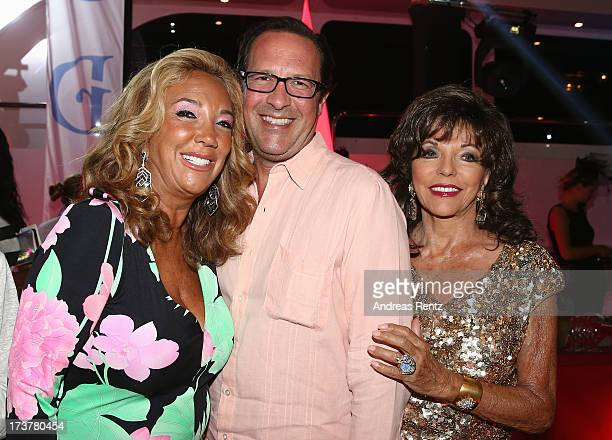 Denise Rich Percy Gibson and Joan Collins attend the Denise Rich annual St Tropez party on July 17 2013 in SaintTropez France