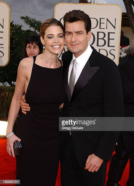Denise Richards and Charlie Sheen arrive at the Golden Globe Awards at the Beverly Hilton January 20 2002 in Beverly Hills California