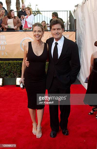 Denise Richards and Charlie Sheen during 2005 Screen Actors Guild Awards Arrivals at The Shrine in Los Angeles California United States