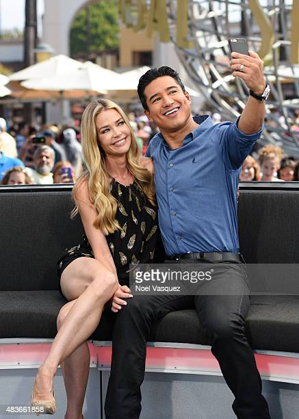 Denise Richards and Mario Lopez visit 'Extra' at Universal Studios Hollywood on August 11 2015 in Universal City California