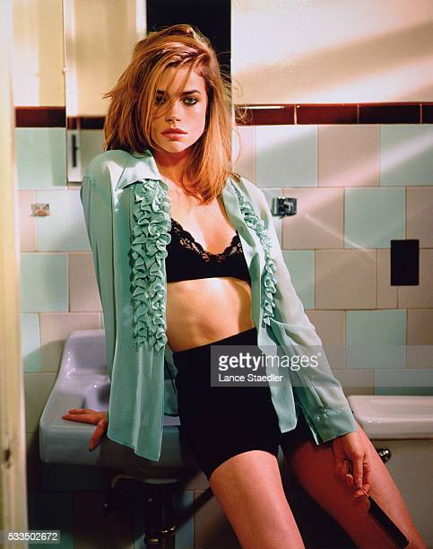 Denise Richards Leaning on Bathroom Sink