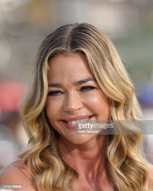 Denise Richards visits Extra at Universal Studios Hollywood on August 13 2018 in Universal City California