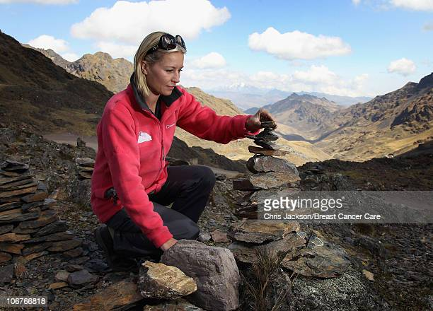 Denise Van Outen places a stone on a traditional pile of stones for good luck at the highest pass into the Lares Valley on day one of Denise and...