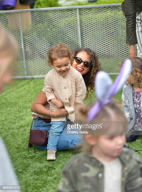 Denise Vasi and daughter Lennox Mae Mandler attend AKID Brand's 3rd Annual 'The Egg Hunt' at Lombardi House on March 17 2018 in Los Angeles California