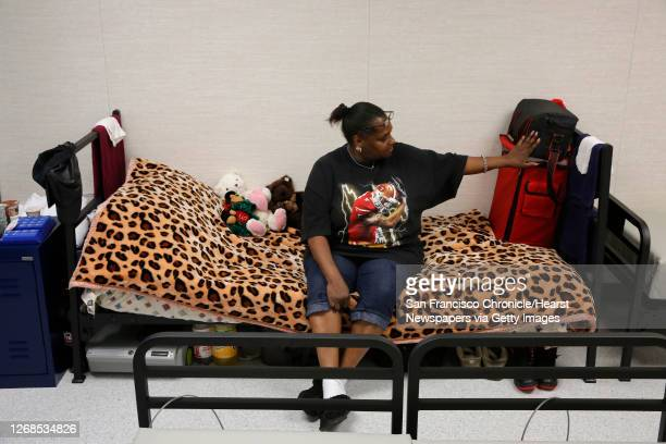 Denise Ward sitting at her sleeping area is one of the first residents to move into the newly opened Dogpatch Navigation Center in San Francisco,...