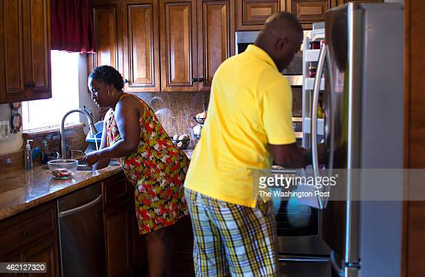 Denise Watson and her husband Samuel Kargbo clean up the kitchen after lunch on August 2 2014 in Upper Marlboro MD Watson bought her twobedroom town...