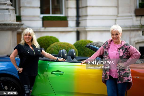 Denise Welch and Samantha Fox pose with the rainbow Bentley during the Henpire podcast launch event at Langham Hotel on September 10 2020 in London...
