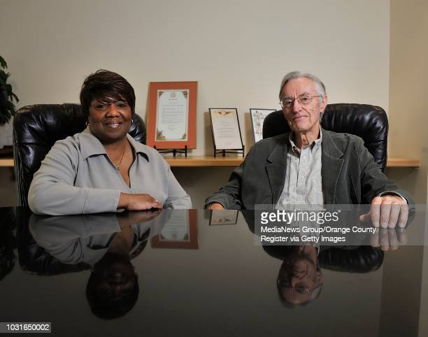 Denise Y Cato president and CEO of the Fair Housing Council of Orange County and Bob Johnson president of the group's board in their new offices in...