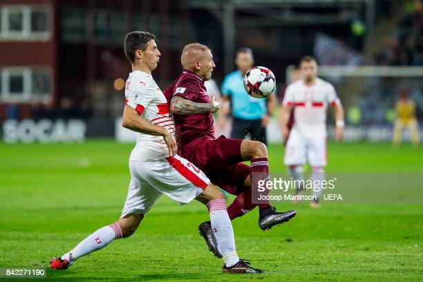 Deniss Rakels of Latvia is fouled by Fabian Schar of Switzerland during the FIFA 2018 World Cup Qualifier between Latvia and Switzerland at Skonto...
