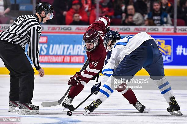 Deniss Smirnovs of Team Latvia and Henrik Borgstrom of Team Finland faceoff during the 2017 IIHF World Junior Championship relegation game at the...