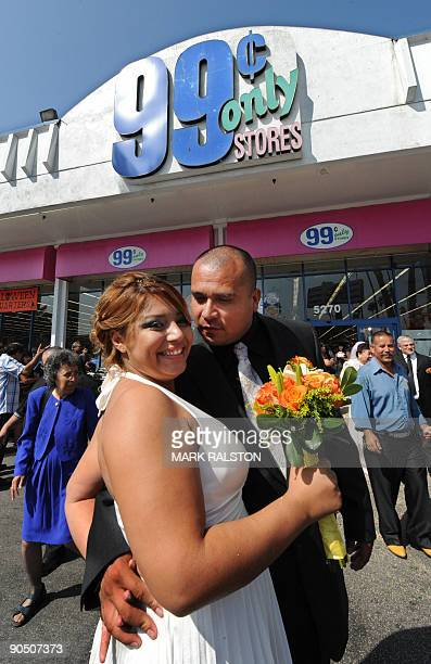 Denisse Navarro and Guadalupe Villagrana embrace after their 99 cent wedding ceremony held at the 99 cent store in Los Angeles on September 9 2009...