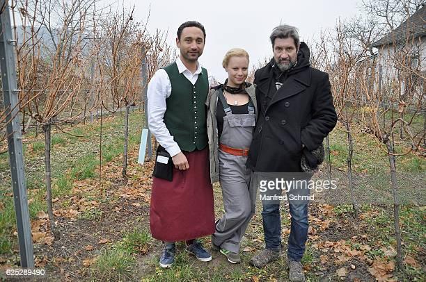 Deniz Cooper Katharina Strasser and director Sascha Bigler pose during the 'Herrgott fuer Anfaenger' set visit in Vienna at Heuriger Sirbu on...