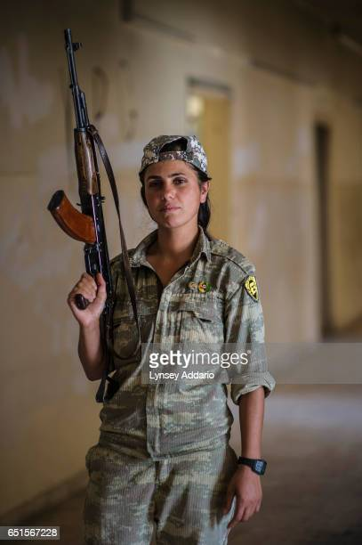 Deniz Derek poses for a portait in an abandoned school being used as a base in the former ISIS and Jabat al Nusra stronghold of Tel Bark which was...