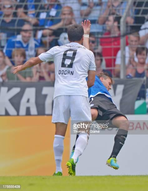 Deniz Dogan of Braunschweig attacks Tom Schuetz of Bielefeld and receives the red card afterwards during the DFB Cup first round match between...
