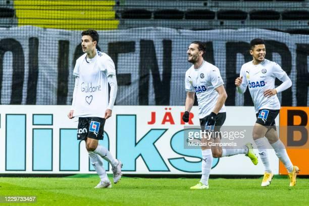 Deniz Hummet of Orebro SK celebrates scoring the 2-0 goal with teammates during the Allsvenskan match between AIK and Orebro SK at Friends Arena on...