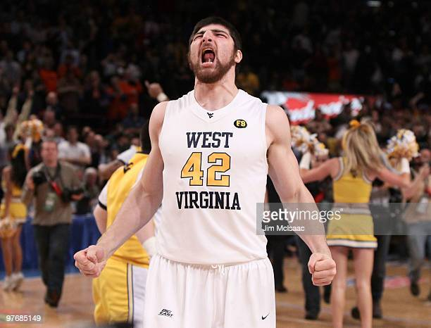 Deniz Kilicli of the West Virginia Mountaineers celebrates after defeating the Georgetown Hoyas during the championship of the 2010 NCAA Big East...