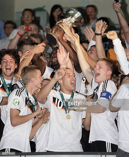 Deniz Naki, Lars Bender, Timo Gebhart and Florian Jungwirth of Germany celebrate after the U19 European Championship final match between Germany and...
