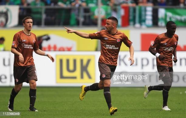 Deniz Naki of Hamburg celebrates with his team mates after scoring his team's first goal during the Bundesliga match between VfL Wolfsburg and FC St....