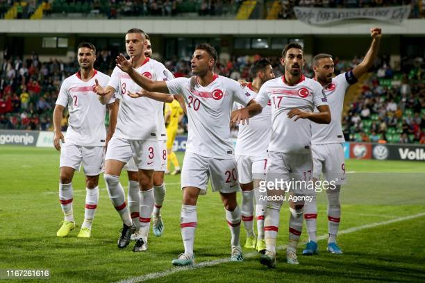 Deniz Turuc of Turkey celebrates with his teammates Cenk Tosun Irfan Can Kahveci Kenan Karaman Zeki Celik Umut Meras and Merih Demiral after scoring...