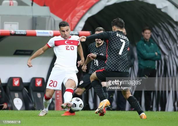 Deniz Turuc of Turkey in action against Josip Brekalo of Croatia during a friendly match between Turkey and Croatia at Vodafone Park in Istanbul,...