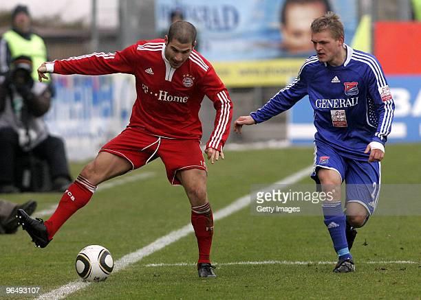 Deniz Yilmaz of Bayern II and Thorsten Schulz of Unterhaching battle for the ball during the 3Liga match between SpVgg Unterhaching and Bayern...