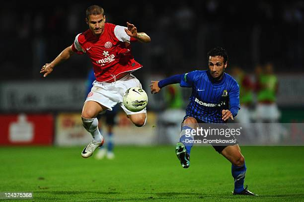 Deniz Yilmaz of Mainz and Cataldo Cozza of Trier battle for the ball during the Regionalliga West match between SV Eintracht Trier 05 and FSV Mainz...