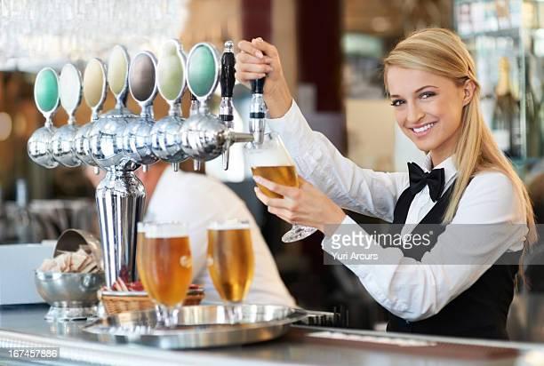 Denmark, Aarhus, Female bartender pouring beer