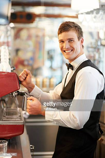 Denmark, Aarhus, Portrait of barista standing by coffee maker