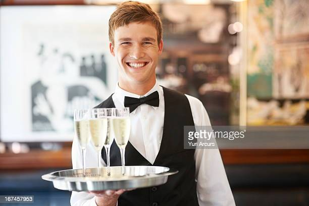 denmark, aarhus, portrait of waiter holding champagne flutes on tray - waiter stock pictures, royalty-free photos & images