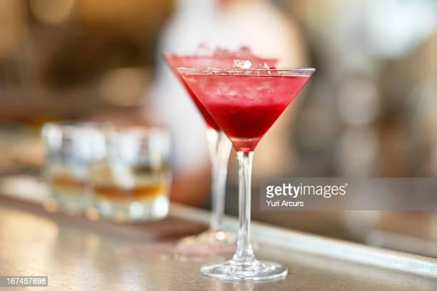 Denmark, Aarhus, Two martini glasses standing on bar counter