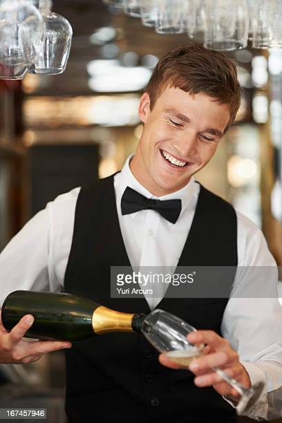 Denmark, Aarhus, Waiter pouring champagne into champagne flute