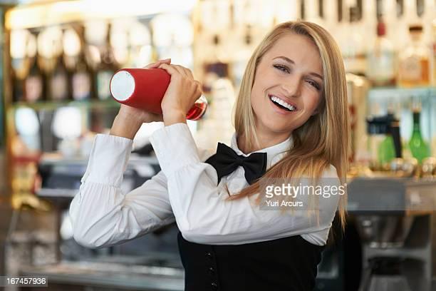 Denmark, Aarhus, Young female bartender using cocktail shaker