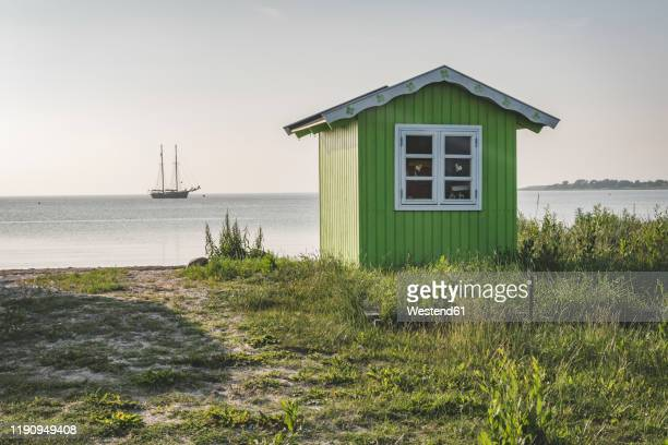 denmark, aeroe, aeroskobing, baths on overgrown beach seen on peaceful day - funen stock pictures, royalty-free photos & images