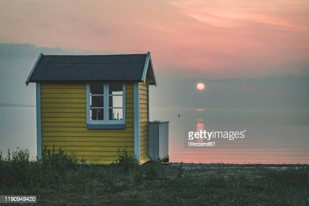 denmark, aeroe, aeroskobing, sunset scenery with traditional baths on beach - funen stock pictures, royalty-free photos & images