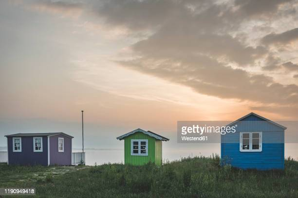 denmark, aeroe, aeroskobing, traditional baths on beach seen at sunset - funen stock pictures, royalty-free photos & images