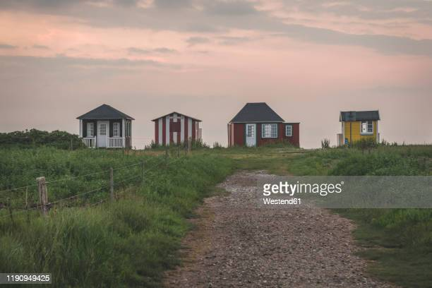 denmark, aeroe, aeroskobing, traditional baths seen at dawn from road - funen stock pictures, royalty-free photos & images