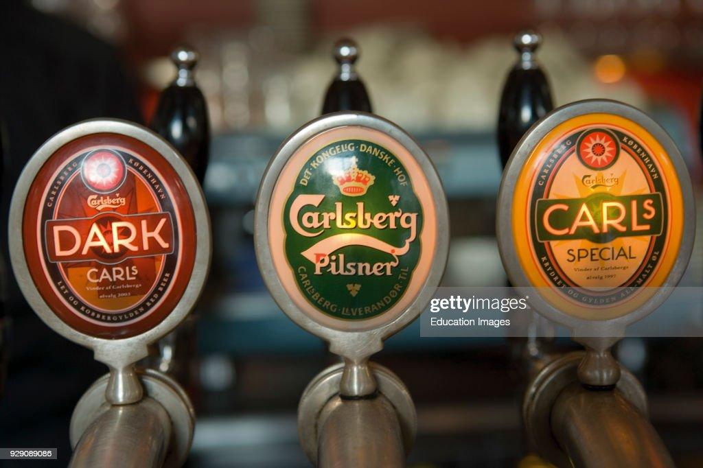 Carlsberg beer taps in bar Pictures | Getty Images