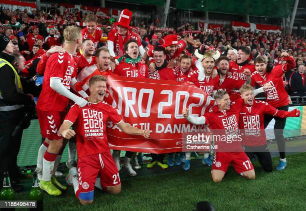 Denmark celebrate and pose for a photograph in front of their fans after the UEFA Euro 2020 qualifier between Republic of Ireland and Denmark at...