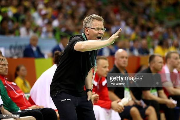 Denmark coach Gudmundur Gudmundsson reacts during the Mens Preliminary Group A match between Denmark and Argentina at the Future Arena on Day 2 of...