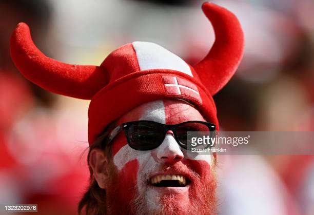 Denmark fan wearing face paint reacts prior to the UEFA Euro 2020 Championship Group B match between Denmark and Finland on June 12, 2021 in...