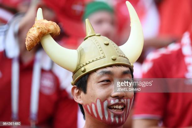 Denmark fan wears a viking helmet before the Russia 2018 World Cup Group C football match between Denmark and France at the Luzhniki Stadium in...