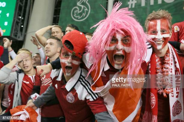Denmark fans celebrate after the FIFA World Cup 2018 qualifying football match second leg between Republic of Ireland and Denmark at Aviva Stadium in...